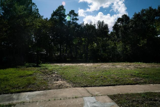 The empty lot of land where John and Heather Papadopoulos' home once stood on Bayou Glen Road.
