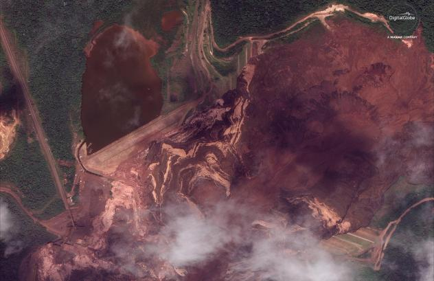 The Vale mining company says that Dam I of the Córrego de Feijão mine was more than 280 feet high and 2,360 feet wide, holding a volume of 11.7 million cubic meters. The ruined mine near Brumadinho, Brazil, is seen here in a satellite photo from Jan. 2