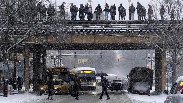Commuters wait for a train as snow falls in Chicago. With a polar vortex hitting the Midwest, wind chills could dip to 55 degrees below zero in northern Illinois.
