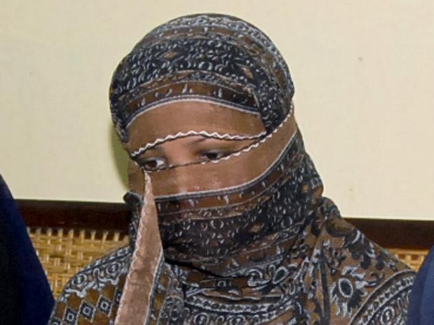 Asia Bibi, photographed in 2010, listens to officials at a prison near Lahore.