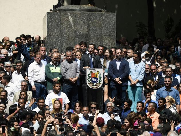 Venezuela's congressional leader Juan Guaidó is being recognized by a rising number of governments, including the U.S., as the country's interim president. In this photo, Guaidó (center) speaks to a crowd of opposition supporters at Bolívar Square in