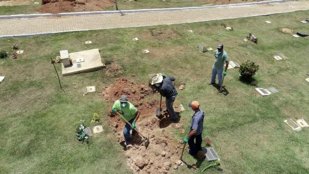 Cemetery workers prepare burial sites for the victims of the collapsed dam in Brumadinho, Brazil, on Tuesday.