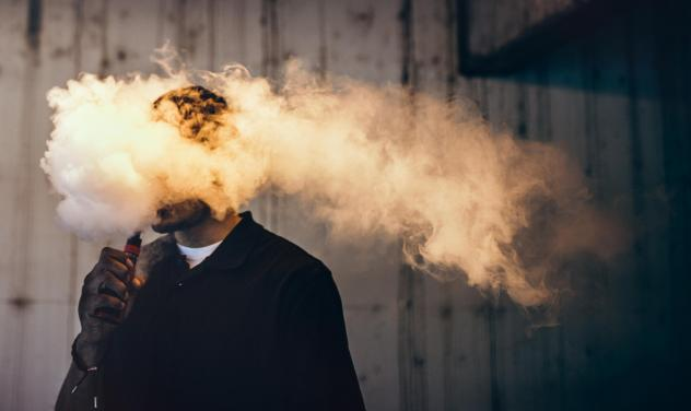 """""""There's a certain notion that e-cigarettes are harmless,"""" says Dr. Paul Ndunda, an assistant professor at the School of Medicine at the University of Kansas in Wichita. """"But ... while they're less harmful than normal cigarettes, their use still comes wi"""