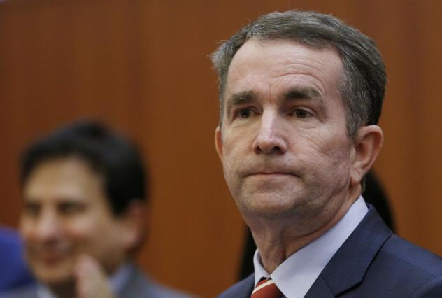 Virginia Gov. Ralph Northam, pictured preparing to address a news conference on Thursday, issued an apology for a racist photo on his medical school yearbook page.