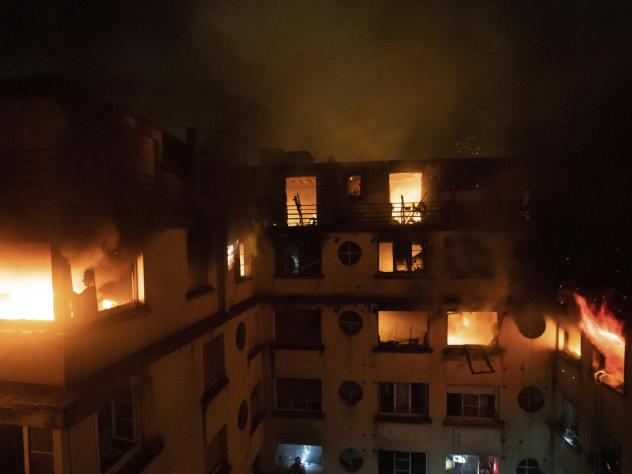 A fire rages through the top floors of an apartment building in Paris. At least 10 people have been killed and dozens injured. Fire officials say arson is to blame.