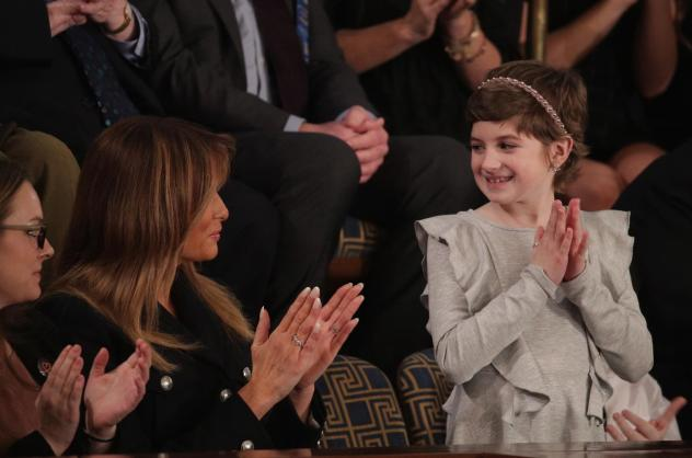 First lady Melania Trump with 10-year-old Grace Eline, a guest of President Trump at the State of the Union address Tuesday. Grace was diagnosed with brain cancer last year. Trump cited her experience in calling for more research into childhood cancer tr