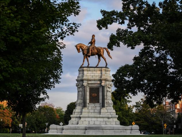 A statue of Confederate Gen. Robert E. Lee stands at the center of Lee Circle along Monument Avenue in Richmond, Va. The commonwealth of Virginia has a complicated racial history that underpins many of today's political controversies.