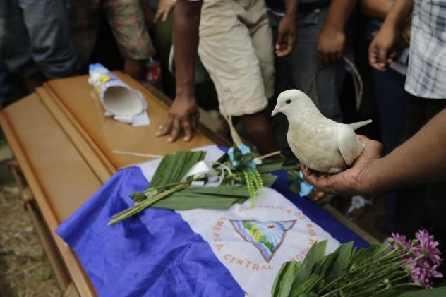 Relatives and friends attend the burial of teenager Matt Romero in Managua, Nicaragua, last September. He was shot dead during clashes between anti-government protesters and riot police and paramilitaries.