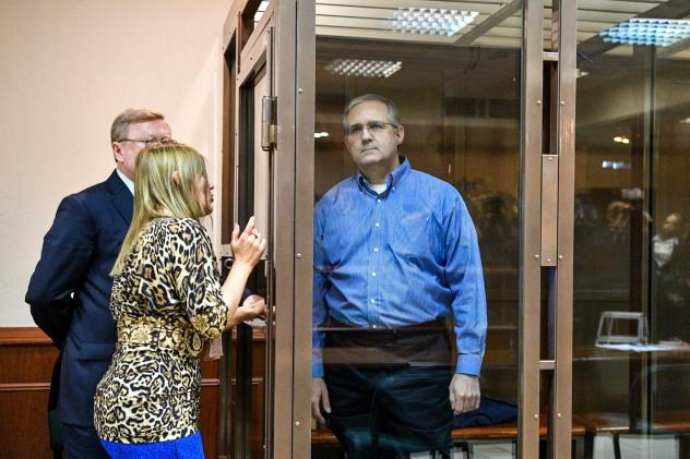 Paul Whelan, an American accused of espionage and arrested in Russia, listens to his lawyers while standing inside a defendants' cage during a hearing at a court in Moscow on Jan. 22.