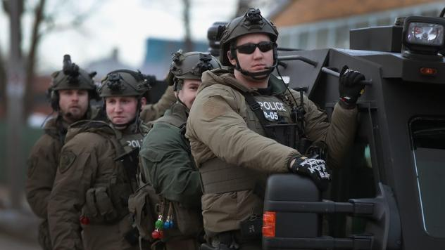 Police secure the area following a mass shooting at the Henry Pratt Co. in Aurora, Ill., on Friday. A gunman killed five people and wounded five police officers before being fatally shot by police.