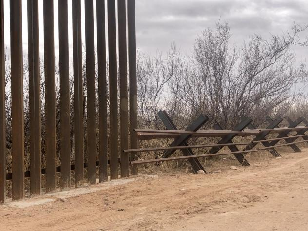 New 18-foot, steel bollard fencing is replacing an old vehicle border near the Santa Teresa Port of Entry in New Mexico. Environmentalists are concerned the new fencing will block off wildlife corridors.