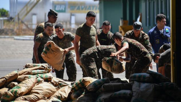 Brazilian soldiers pile humanitarian aid in Boa Vista, Brazil near the border with Venezuela on Friday. Venezuelan activists are vowing to bring it into Venezuela this weekend.