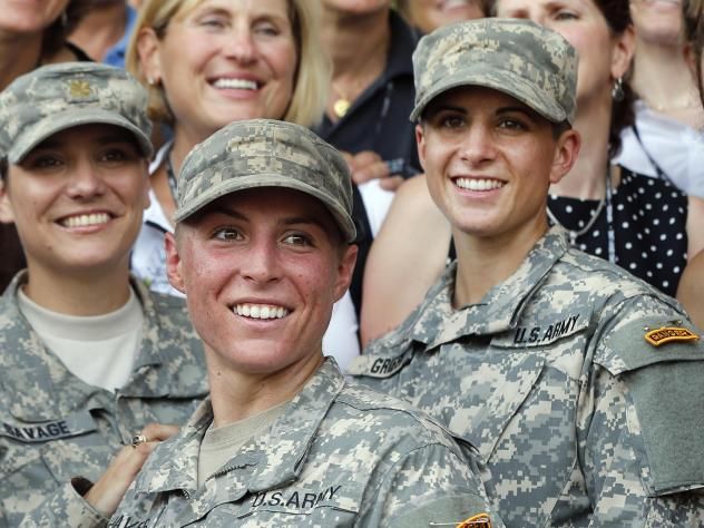 Army 1st Lt. Shaye Haver (center) and Capt. Kristen Griest (right) pose for photos with other female West Point alumni after an Army Ranger school graduation ceremony at Fort Benning, Ga., in 2015. They were the first two women to graduate from U.S. Army