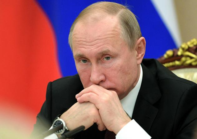 Russian President Vladimir Putin chairs a cabinet meeting in the Kremlin in Moscow on Wednesday.