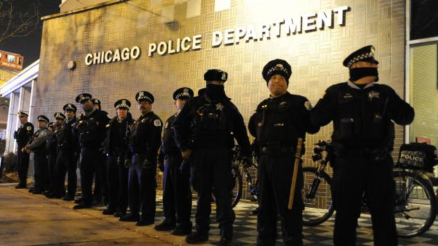 Chicago police officers line up outside the District 1 central headquarters during a protest of the police shooting of 17-year-old Laquan McDonald. The shooting death became a rallying cry for activists calling for police reform.
