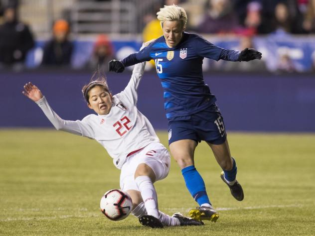 U.S. Women's National Soccer Team forward Megan Rapinoe, right, tries to get around Japan's Risa Shimizu, left, with the ball during the first half of SheBelieves Cup soccer match, Wednesday, Feb. 27, 2019, in Chester, Pa. The U.S. tied Japan 2-2 in a fr
