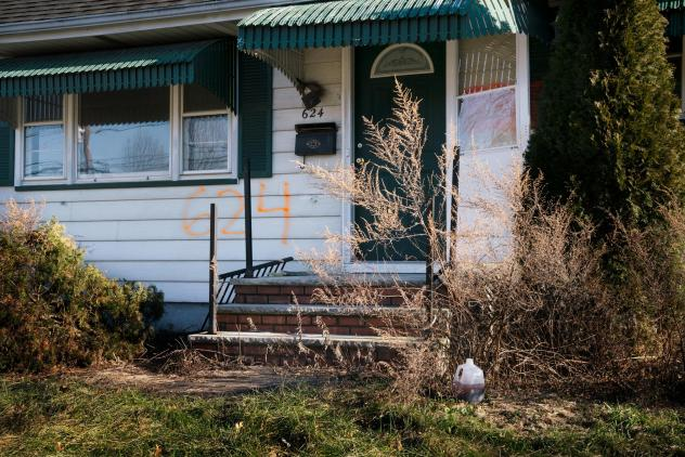 A home in the Lost Valley area of Manville, N.J. The numbers spray-painted on the front of the house indicate that it was bought as part of a federal disaster program.