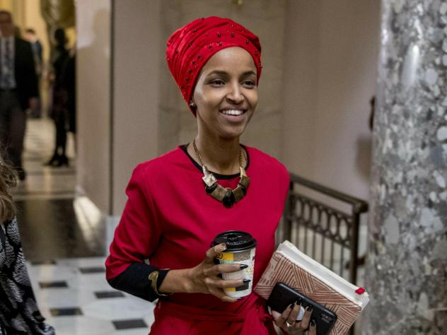 Rep. Ilhan Omar, D-Minn., walks through the halls of the Capitol Building in Washington. In Omar's Minnesota district, both Jews and Muslims voiced concern about her comments on Israel.