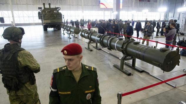 Russian military officers stand by as the 9M729, center, its launcher, left, and the 9M728, right, land-based cruise missiles are displayed in Kubinka outside Moscow, in January. The Russian military rolled out its new missile and spelled out its specifi