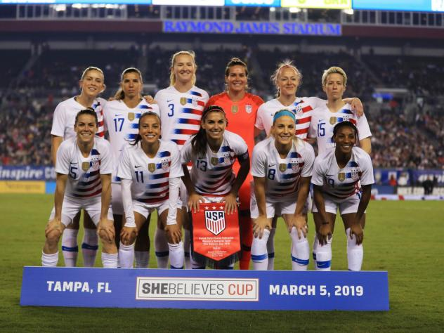 The members of the U.S. women's national soccer team filed a lawsuit Friday against U.S. Soccer, accusing it of gender discrimination. The starting 11 are seen here before playing Brazil earlier this week in Tampa, Fla.