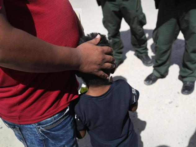 U.S. Border Patrol agents take a father and son from Honduras into custody near the U.S.-Mexico border on June 12, 2018 near Mission, Texas. The asylum seekers were then sent to a U.S. Customs and Border Protection processing center for possible separati