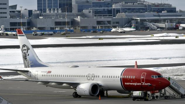 A Norwegian Air Boeing 737 Max 8 is parked on the tarmac at Helsinki Airport on Wednesday after the airplane model was grounded in most of the world.