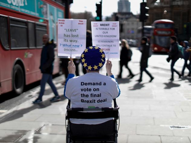 An anti-Brexit activist demonstrates outside of the Houses of Parliament in London on Thursday, before a vote on whether to postpone Britain's exit from the European Union.