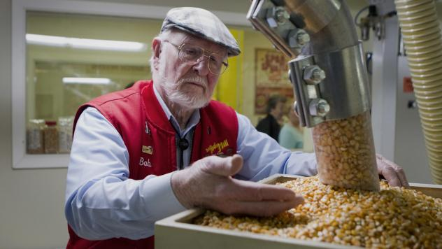 Bob Moore, founder of Bob's Red Mill and Natural Foods, inspects grains at the company's facility in Milwaukie, Ore. The pioneering manufacturer of gluten-free products invests in whole grains as well as beans, seeds, nuts, dried fruits, spices and herbs