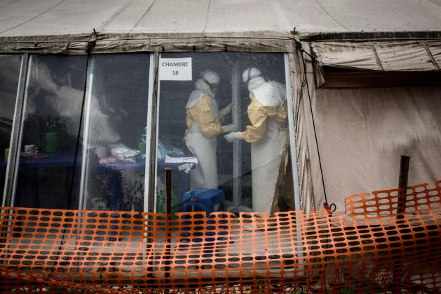 """Health workers inside the """"red zone"""" of an Ebola treatment center in Butembo, which was attacked on March 9."""