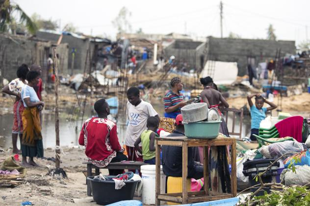 Residents of the city of Beira, which was nearly destroyed by Cyclone Idai, salvage what is left of their belongings.