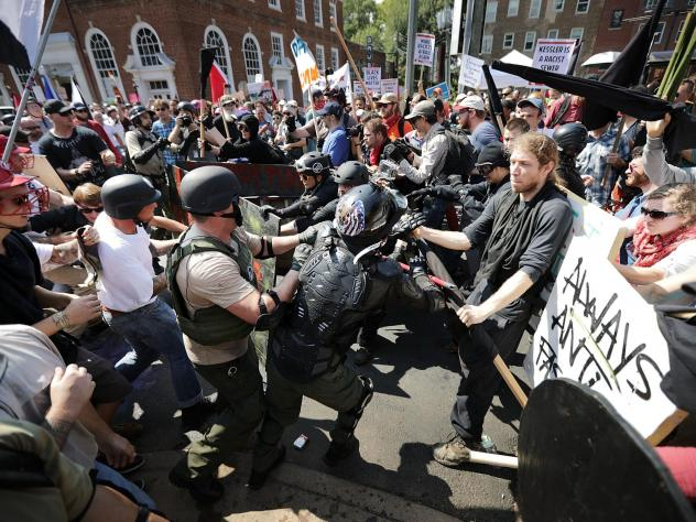 """White nationalists, neo-Nazis and members of the """"alt-right"""" clash with counter-protesters in Charlottesville, Virginia during the """"Unite the Right"""" rally August 12, 2017."""