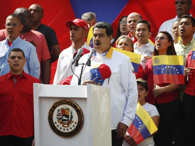 Venezuela's President Nicolás Maduro sings the national anthem during an anti-imperialist rally for peace, in Caracas, Venezuela, on Saturday.