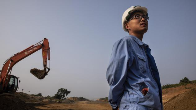 A Chinese site engineer is seen during construction of an extension of the Southern Expressway in Sri Lanka, in November. The project is part of Beijing's massive Belt and Road Initiative.