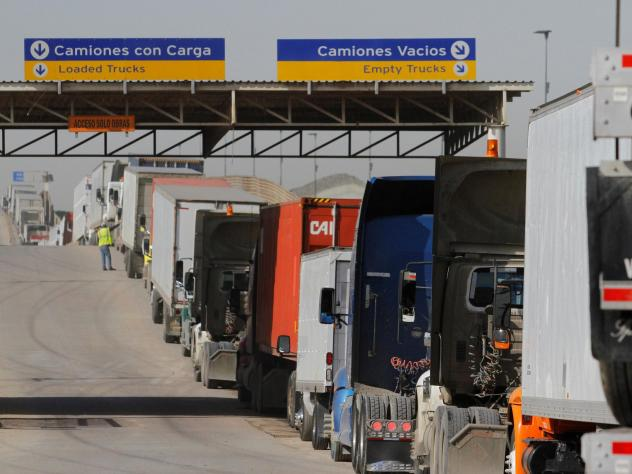 Trucks wait to enter the United States at the border crossing in Tijuana, Mexico, Feb. 2, 2017. More than $1.6 billion in goods flow across the border each day.