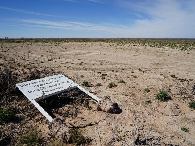 A sign at the proposed interim nuclear storage site lies on its side and is riddled with bullet holes.