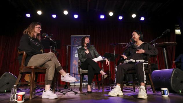Host Ophira Eisenberg chats with Lesyle Headland and Greta Lee on <em>Ask Me Another</em> at the Bell House in Brooklyn, New York.