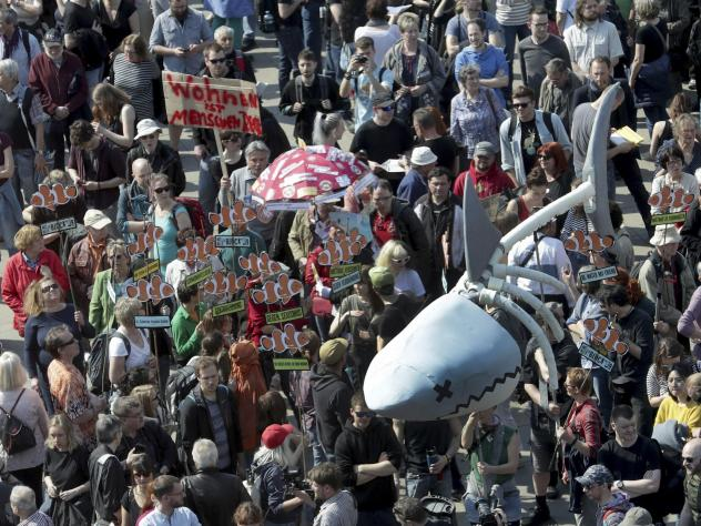 """Protesters in Berlin carry a giant """"rent shark"""" at a march against rent increases on Saturday."""