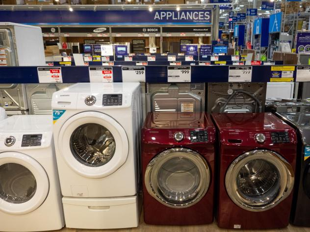 Overall, prices of major appliances tracked by the consumer price index are starting to tick down month-to-month. But they are still higher than they were last year. Washing machines, dryers and other appliances are seen for sale at a Lowe's home improve