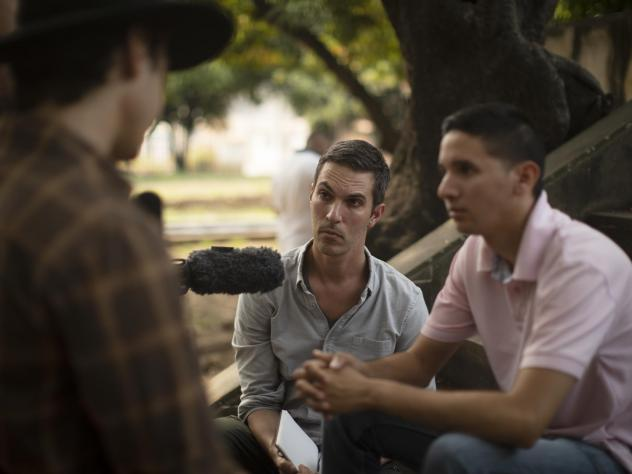 NPR's Ari Shapiro (center) interviews former Venezuelan special forces official Williams Cancino (right) in the Colombian town of Villa del Rosario.