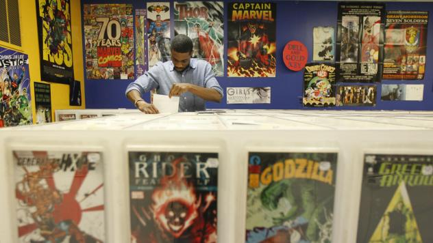 Ron Ackins checks out back issues at Philadelphia's Fat Jack's Comicrypt on Free Comic Book Day 2012. Be like Ron.