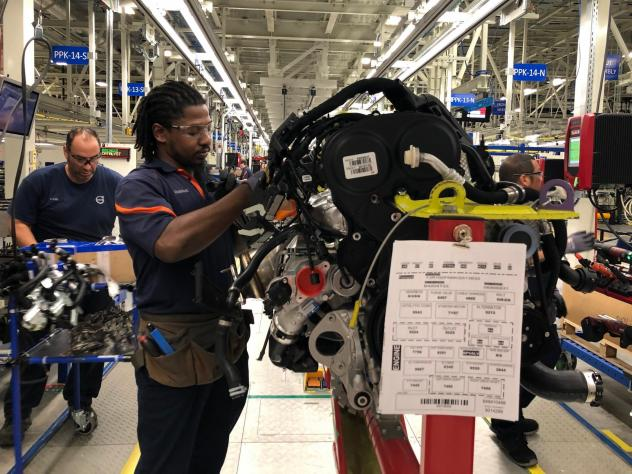 Tremaine Smalls attaches parts to an engine at Volvo's plant in Ridgeville, S.C. The automaker has shifted its exports to Europe as the result of the U.S. trade war with China.