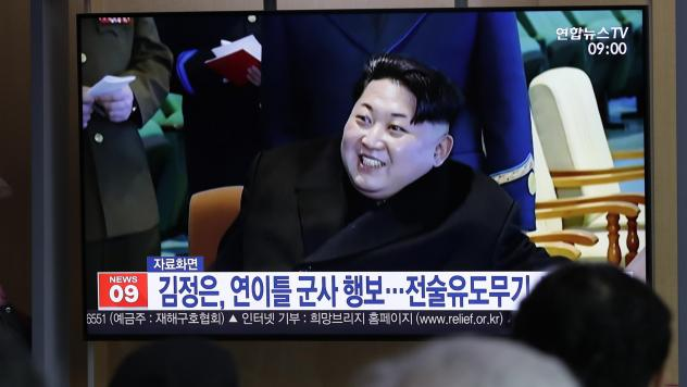 "A TV report in South Korea uses file footage of North Korean leader Kim Jong Un, who supervised the test-firing of a ""new-type tactical guided weapon"" on Wednesday."