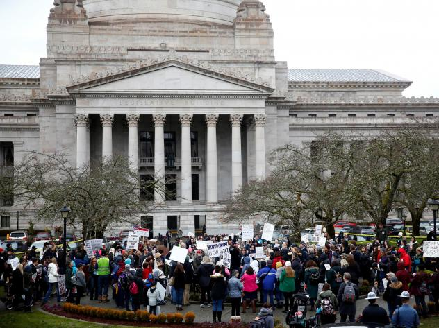 The Washington state Senate passed a bill on Wednesday that would remove the personal belief exemption from the required vaccinations for measles, mumps and rubella. Here, people protest the related house bill outside Washington's Legislative Building in