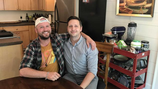 Greg McDonald Jr. (left) sits with his fiancé Jon Jost. McDonald's parents considered sending him to counseling when they were concerned he was gay. Now they support a ban on conversion therapy.
