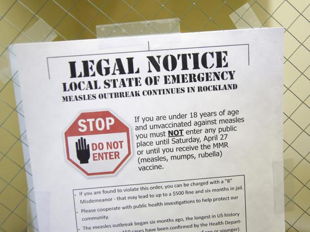 A sign explaining the local state of emergency because of a measles outbreak at the Rockland County Health Department in Pomona, N.Y.