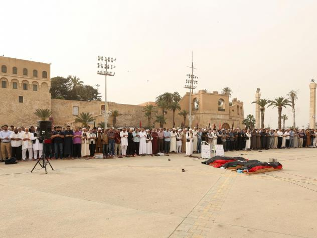Mourners gather for funeral prayers for fighters killed by warplanes of Khalifa Haftar's forces on April 24 in Tripoli, Libya.