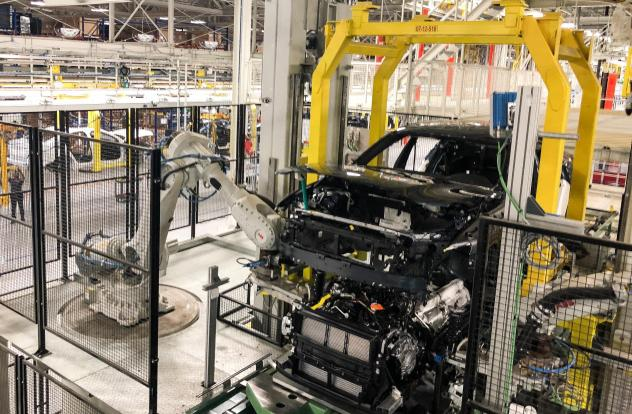 A robotic arm works on the production line at Volvo's factory in Ridgeville, S.C. But other essential jobs, including major portions of final assembly, are still left to people.