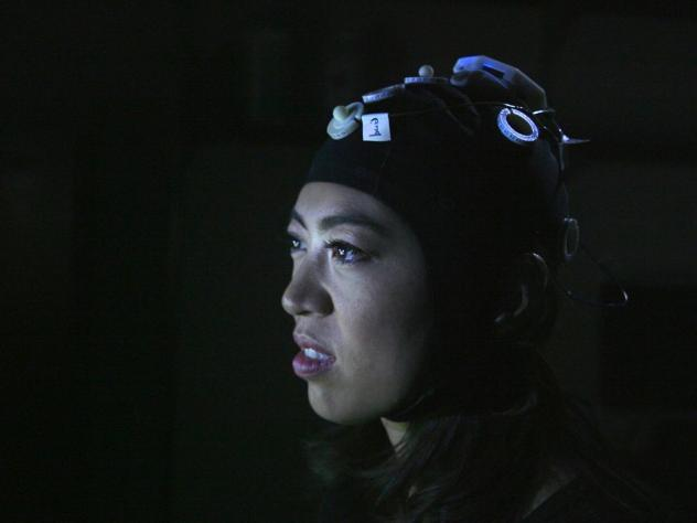 NPR's Elise Hu wears a cap that connects her to a network of other people playing a Tetris-like game at the University of Washington's Center for Neurotechnology.