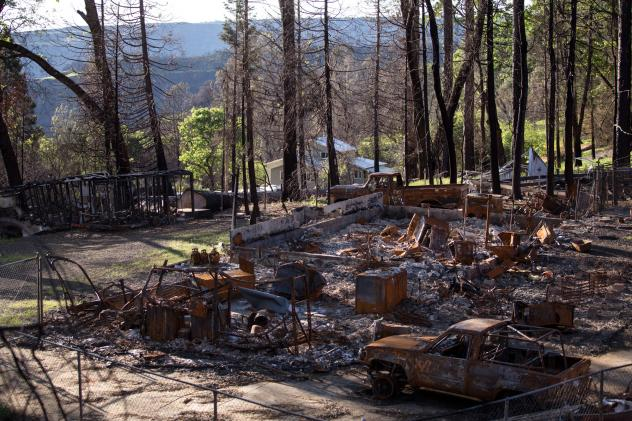 A burned-out property sits next to a home that's still standing near Paradise six months after the Camp Fire. The fire was the deadliest and most destructive wildfire in California history.