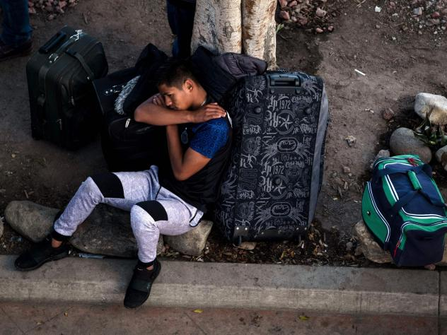 An asylum-seeker rests outside El Chaparral port of entry while he waits for his turn to present himself to U.S. border authorities to request asylum, in Tijuana, Mexico, last month. A federal appeals court has granted the Trump administration's request